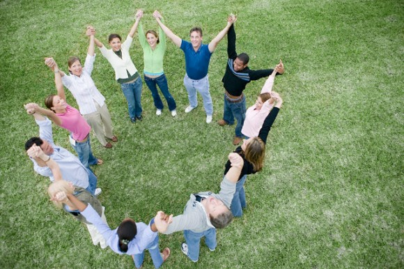 Group Holding Hands and Celebrating in a Circle