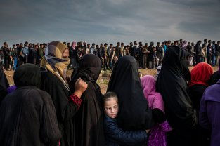 Picture nominated for the World Press photo of the year award shows civilians who had remained in west Mosul during the battle to retake the city, lined up for an aid distribution in the Mamun neighbourhood. World Press Photo/Ivor Prickett/Handout via Reuters NO RESALES. NO ARCHIVES