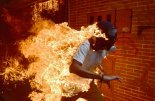 (FILES) In this file photo taken on May 03, 2017 A demonstrator catches fire during clashes with riot police within a protest against Venezuelan President Nicolas Maduro. A searing image of a Venezuelan protestor who caught fire during clashes with riot police has won AFP photographer Ronaldo Schemidt a nomination for the 2018 World Press Photo award. The Mexico-based snapper for Agence France-Presse is among six photographers, chosen from more than 4,500 hopefuls, to be nominated for the prestigious annual prize, the World Press Photo Foundation in Amsterdam revealed on February 14, 2018. / AFP PHOTO / RONALDO SCHEMIDT